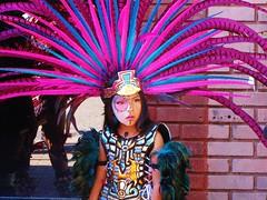 Cool (Gerry Dincher) Tags: internationalfolkfestival parade fayetteville cumberlandcounty northcarolina downtownfayetteville personstreet haystreet marketsquare mexican aztec dancers purple child nino nina feathers headdress