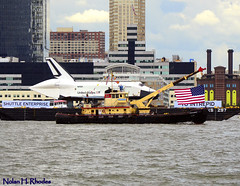 Historic Day For The Shutte Enterprise (nrhodesphotos(the_eye_of_the_moment)) Tags: wood nyc metal flying sailing waterfront skyscrapers rooftops unitedstates crane nj americanflag historic nasa event international smokestack hudsonriver spaceship masts epic barge hoboken buidlings nationalgeographic flyingmachine newsworthy aeroplace shuttleenterprise internationalflags intreprid nrhodesphotosyahoocom wwwflickrcomphotostheeyeofthemoment dsc5802nhr usarmyengineercorps