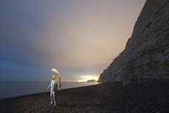 Olympic Dreams (Alex Bamford) Tags: beach night brighton britain pebbles cliffs flame torch olympic pyjamas 2012 sleepwalking torchrelay