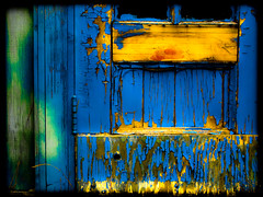 4352 . duchess of hume street (Steven Schnoor) Tags: door hinge wood blue orange usa color detail green art yellow canon wooden saturated colorful painted worn seafood 5d weathered peelingpaint distressed breakwater fstreet schnoor simplelogic wishkahriver humestreet urbandetailspool