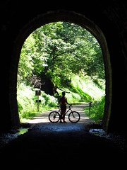 Exit of Tunnel 3, 30 June 2012 (ed_needs_a_bicycle) Tags: silhouette wisconsin cycling cyclist unitedstates tunnel trail maureen 2012 biketrail cycleride traintunnel elroyspartatrail driftlessregion spartaelroytrail