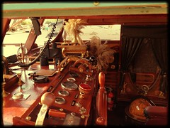 At the Helm (lisahill88) Tags: ontario canada wheel radio glasses boat dock globe steering harbour feathers binoculars curtains fireextinguisher peterborough compass dials helm littlelake bessiemay