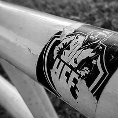 Original HFF. (Dikke Biggie.) Tags: 52in2016 37letters letter letters happyfencedfriday hff fence fenced fencing fencedfriday hek hekwerk friday vrijdag sticker stickerhff blackandwhite bw black white zwartwit zw zwart wit monochrome monochroom dof depthoffield scherptediepte bokeh closeup detail macro samsung samsunggalaxy phonephoto phonepicture telefoonfoto dgawc