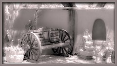 Waiting Room (Sugardxn) Tags: sugardxn canon canon7d canoneos7d cactus garypentin tubac arizona az bench wagon bw blackandwhite wheel southwest wooden statuary stucco photoshop picswithframes frame frames prickly pricklypear sit rest waitingroom wait