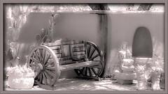 Waiting Room (Sugardxn) Tags: sugardxn canon canon7d canoneos7d cactus garypentin tubac arizona az bench wagon bw blackandwhite wheel southwest wooden statuary stucco photoshop picswithframes frame frames prickly pricklypear sit rest waitingroom wait