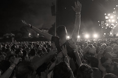 Carried Away... (DCullenV) Tags: photo photography street streetphotography concert audience people crowd crowdsurfing candid foto fotografia blackandwhite blancoynegro blackwhite bw drama night stage arms aloft lights contraluz rangefinder handheld digital fuji fujifilm x100t exterior glare high contrast summer music festival chicago lollapalooza grantpark illinois usa urban redhotchilipeppers public park decv david cullen vidal sepia geotagged ps rhcp hands support rock altrock lowkey 2016