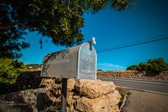 A misplaced mailbox (Oddiseis) Tags: formentera balearicislands spain lamola mailbox light colors tree wall stone stonewall road rural post american misplaced village summer island mediterranean mail sigma2014art