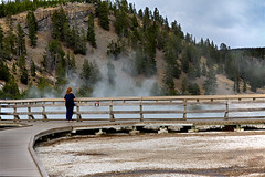 Carolyn At Excelsior Geyser 7511 (casch52) Tags: geyser hot nature steam yellowstone park water wyoming excelsior basin geothermal volcanic tourism national spring midway travel blue thermal landscape beauty crater vacation heat pool boiling beautiful wilderness volcano turquoise america scenic natural outdoors colorful lake horizontal orange color sky outdoor destination mineral algae usa landmark aqua multicolored extreme warmth tamron 1750mm f28 canon 7d