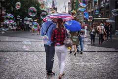 Stride through the rain... (beyondhue) Tags: rain umbrella bubble blow prague street shot people couple walk stroll cover sidewalk pavement wet cobblestone czech republic beyondhue travel summer