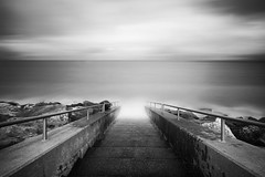 Take your last dance with me (Anthony Owen-Jones) Tags: ocean uk longexposure sky blackandwhite bw cloud black water monochrome lines wales clouds stairs canon landscape eos rebel mono bay landscapes photo kiss moody unitedkingdom horizon picture gimp minimal filter photograph le ethereal nd milky postprocess minimalist bnw conwy hoya t3i x5 rhosonsea northwales leadinglines canonefs1022mmf3545usm rhos sep2 600d takenwith 10stop nd110 nd16 rebelt3i kissx5 anthonyowenjones anthonyowenjonescom
