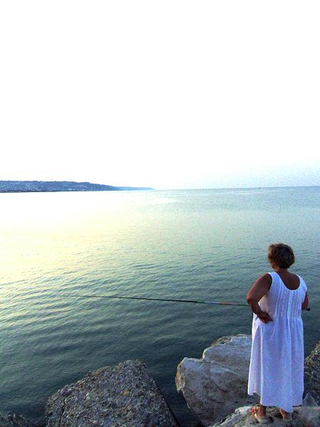 WOMAN FISHING. San Benedetto