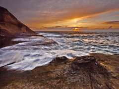 Washing ashore (Dave Arnold Photo) Tags: ocean sea cliff usa mountain beach oregon coast us photo sand surf pacific image or arnold picture wave pic photograph cape centralcoast ore pacificcoast pacificcity capekiwanda kiwanda highseas highsurf crashingwave davearnold centraloregoncoast greenseas davearnoldphotocom kiwandastatepark mygearandme violentwave capehead