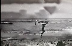 rimasater (Aistis C.) Tags: summer white canada black film beach water girl running damaged
