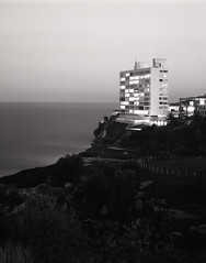 Apartments, Sydney (Geoff A Roberts) Tags: sea urban bw cliff night landscape apartment swiss geoff sydney large gap australia metric f 4x5 format suburb block roberts rodinal ilford fp4 arca 5x4 rodenstock adonal 210mm sironar