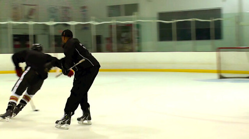 Brad Perry working on puck protection with a student