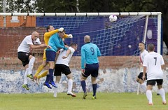 Robert Tiropoulos gets a fist on the ball despite close attention (Stevie Doogan) Tags: clydebank glasgow perthshire exsel group sectional league cup wednesday 10th august 2016 holm park
