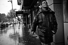 Catching Raindrops? (stimpsonjake) Tags: nikoncoolpixa 185mm streetphotography bucharest romania city candid blackandwhite bw monochrome rain catchingraindrops man coat wet