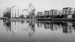 And we get lifted as the night gets nearer (OR_U) Tags: 2016 oru france strasbourg 169 widescreen presquleandrmalraux bw blackandwhite blackwhite schwarzweiss architecture city canal bassindausterlitz water reflections crane
