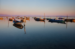 a moment we shared (helen sotiriadis) Tags: longexposure pink blue sunset sea sky orange reflection water yellow canon landscape boats fishing published purple greece waterscape canonefs1022mmf3545usm messolonghi canoneos40d