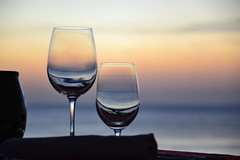 Glasses (Simon_sees) Tags: wineglass glasses glass sunset sea beach ocean afternoon dinner dining romance romantic bali intercontinental jimbaranbay indonesia tropical island holiday getaway honeymoon vacation resort relax wine asia alcohol stilllife