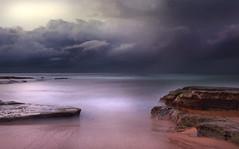 Purple Dreams (edwinemmerick) Tags: ocean longexposure sea sky cloud 20d beach water weather canon eos coast sand rocks shoreline australia le shore nsw slowshutter coastline centralcoast edwin sandybeach wamberal emmerick wamberalbeach edwinemmerick