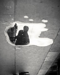 wet silhouettes (>TIM<) Tags: vienna wien street blackandwhite bw reflection water rain silhouette puddle 50mm dof