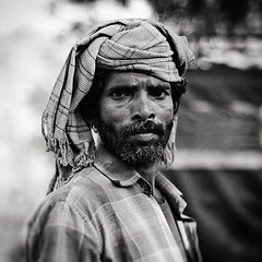 A Rajasthni local worker (snowpine) Tags: street portrait people blackandwhite bw india square candid streetportrait rajasthan   nikond700 rajasthaniman manwithearring xuesongliao