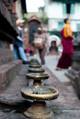 . (alankaar) Tags: nepal lamp temple nikon worship asia monk kathmandu nikkor d60 1855mmf3556gvr