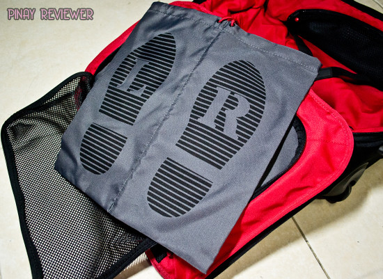 The Crumpler Dry Red No 3 luggage comes with a foldaway shoe bag