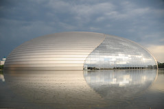 Gorgeousness (Huey Yoong) Tags: china city urban building water architecture modern reflections asia day theatre cloudy capital beijing stormy landmark theegg avantgarde peoplesrepublicofchina dramaticskies nationaloperahouse 5photosaday