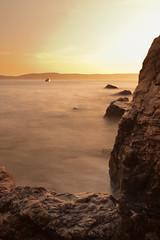 Sunset in Croatia (Cocktus) Tags: ocean longexposure travel sunset sea holiday beach nature water yellow rock landscape boat europe horizon croatia boulder split maisema 2012 auringonlasku