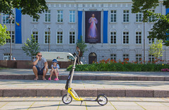 Just a Typical Father Daughter (and Jesus) Day (Roblawol) Tags: baltics capital daughter day daytime europe exhibition father flowers garden girl jesus lithuania man scooter summer vilnius