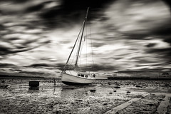 Kamouraska (ISP Bruno Laplante) Tags: stlawrence river kamouraska sky clouds black white boat sail long exposure nature outdoor low tide