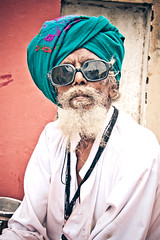 That's one cool muddy funster. (Paki Nuttah) Tags: life travel portrait people india man male face beard asian person glasses cool asia looking turban gujarat dud bhuj gujarati