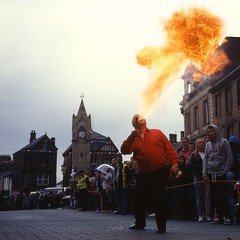 Fire (polarisandy) Tags: rolleiflex vintage mediumformat square fire slide 66 64 cumbria squareformat entertainer medium analogue ektachrome streetentertainer penrith planar 75mm fireblower 35f epr iso64 heidosmat polarisandy blinkagain