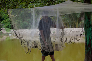 A farmer dries his net. Aceh, Indonesia. Photo by Mike Lusmore/Duckrabbit, 2012