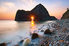 The moment of blessings! Sunset at Senganmon (-TommyTsutsui- [nextBlessing]) Tags: longexposure light sunset sea orange sun seascape black beach nature yellow rock japan landscape spring nikon magic tide scenic wave shore     islet izu    matsuzaki  sigma1020   onsalegettyimages senganmon