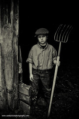 Farmer Boy (sandyolson) Tags: portrait children black white beautiful child girl boy bw blackandwhite silverscreen cleopatra monroe antique old classic renaissance photography baroque history macro johnlennon irlambriggs wildlife chiaroscuro awardwinning