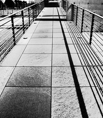 Stripes, Lines and Shadows (Blue Rave) Tags: 2012 germany europa building deutschland europe berlin lines line vanishingpoint pathway angles angle sidewalk path diagonal architecture cross thecross bw blackandwhite stripes