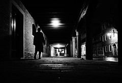 nouvelle vague (Emiliano Grusovin) Tags: street city venice shadow blackandwhite bw hat silhouette night strada mood sony ombra highcontrast evil bn pancake alpha cinematic 16mm venezia f28 notte biancoenero cappello filmnoir città altocontrasto mirrorless nex3