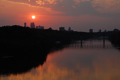 Sunset Over the Twin Cities (Randy Baranczyk) Tags: bridge sunset sun reflection water minnesota river dusk minneapolis mississippiriver twincities saintpaul
