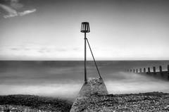 Standing on the shore line (Craigraymond82) Tags: longexposure sea blackandwhite bw beach sussex worthing filter groyne weldingglass weldersglass