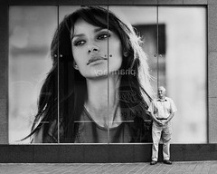 Just Waiting (Peter.Bartlett) Tags: street city people urban blackandwhite man monochrome advertising mono blackwhite waiting candid sony yorkshire leeds streetphotography nik alpha westyorkshire advertisinghoarding blackwhitephotos sonyalpha streetphotographyurban alpha700 sonyalpha700 niksilverefex