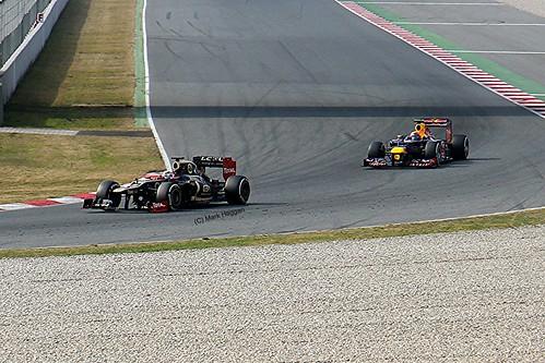 Mark Webber's Red Bull following the Lotus F1 car of Kimi Raikkonen at Formula One Winter Testing, Circuit de Catalunya, March 2012
