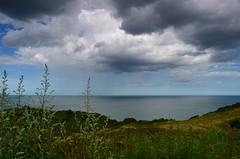 010 (mark.tucker9) Tags: ocean blue sea england sky cloud storm green water grass rain dark countryside view norfolk meadow cromer
