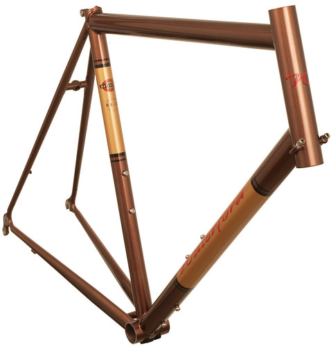 <p>This is a 33-Series frame using our Road Sport handling and head tube cable guides.  The rider hydrates heavily during rides; hence the unusual combination of a 3rd set of water bottle bosses with no eyelets or rack mounts.  Styled Copper Met with Goldfinge Panels.</p>