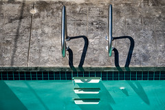 'Implied' (Canadapt) Tags: swimmingpool ladder graphic abstract shadow shape vancouver bc canadapt