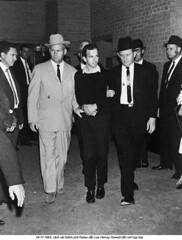 Lee Oswald    Kennedys Assassin (28) (ngao5) Tags: adults americans assassination assassinationofpresidentkennedy1963 broadcasting clothing communications crime dallas dallascounty death escorting fulllength government group guard historicevent johnfitzgeraldkennedy leeharveyoswald males many men murder northamerica northamericanhistoricalevent occupationsandwork outfit people politicalandsocialissues pressconference prominentpersons suits suspect telecommunications television texas unitedstateshistoricalevent usa whites