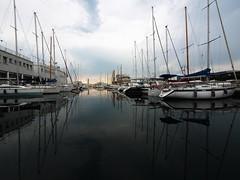 Trieste_005_7144 (Dubliner_900) Tags: olympus omdem5markii panasoniclumixgvario714mmf4asph micro43 paolochiaromonte trieste friuliveneziagiulia riflessi boat reflections