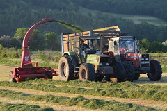 Deutz Fahr DX Tractor with a JF FCT900 Trailed Silage Harvester filling a Silage Trailer drawn by a Massey Ferguson 399 Tractor (Shane Casey CK25) Tags: deutz fahr dx tractor jf fct900 trailed silage harvester filling trailer drawn massey ferguson 399 sdf agco mf red green ballyduff samedeutzfahr deutzfahr vintage silage16 silage2016 grass grass16 grass2016 winter feed fodder county ireland irish farm farmer farming agri agriculture contractor field ground soil earth cows cattle work working horse power horsepower hp pull pulling cut cutting crop lifting machine machinery nikon d7100 traktori tracteur traktor trekker trator cignik collecting waterford